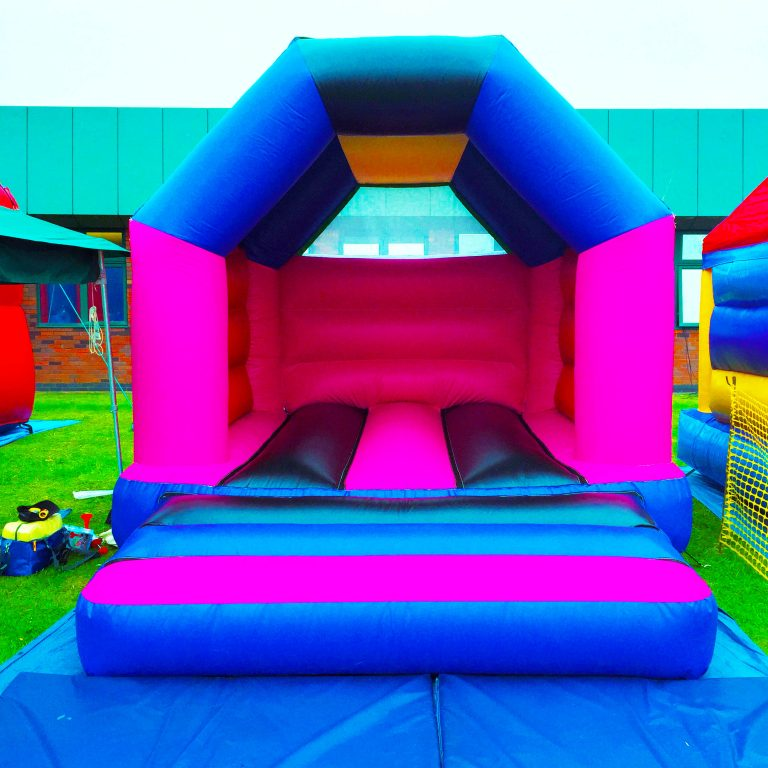 pink blue and black bouncy castle